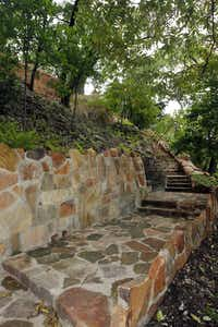 Hillside Terrace, a trail network of meandering stone stairwells, lookouts and seating spaces, clings to a bluff at Reverchon Park in Dallas, providing shade, privacy and views. The Dallas Park and Recreation Department spent $2.1 million restoring and updating the park's elaborate stonework, including an amphitheater, entry fountain and bridge over Turtle Creek, built in the 1930s by Works Progress Administration crews.Michael Ainsworth - Staff Photographer