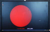A live feed of the transit of Venus is shown on a computer screen at the University of Texas at Dallas.