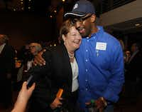County Commissioner candidate Theresa Daniel  gets a hug from Roy Williams Jr., constable for Precinct 4, at the Dallas County Democratic watch party at the Hyatt Regency Dallas.