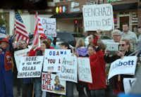 Protestors stood outside as President Barack Obama speaks at Temple Emanu-El.