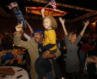 Gary Crosby of Richardson celebrates with his son, Dillon, and JIll Brandenburg of Carrollton as Barack Obama was announced the winner of the presidential election at the Dallas County Democratic watch party at the Hyatt Regency Dallas.