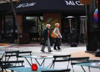 Sidewalk cafes, boutiques, and a movie theater help draw people to the West Village in Dallas. There are walkable neighborhoods in Dallas like the Bishop Arts District, Deep Ellum, and the West Village, but downtown Dallas is still lacking that extra something that attracts more pedestrians, shoppers, and diners.Mona Reeder  -  Staff Photographer