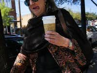 A woman carried her coffee to go in Bishop Arts on Friday afternoon, March 07, 2014. There are walkable neighborhoods in Dallas like the Bishop Arts District, Deep Ellum, and the West Village, but downtown Dallas is still lacking that extra something that attracts more pedestrians, shoppers, and diners.Mona Reeder  -  Staff Photographer