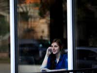Molly Clemans, who lives in the Uptown area near the West Village, sat at window table in Starbucks Friday morning, March 07, 2014, taking in the sites. There are walkable neighborhoods in Dallas like the Bishop Arts District, Deep Ellum, and the West Village, but downtown Dallas is still lacking that extra something that attracts more pedestrians, shoppers, and diners.Mona Reeder  -  Staff Photographer