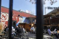 Cane Rosso is a popular restaurant that draws people to the Deep Ellum neighborhood. On Friday, March 07, 2014, diners took advantage of warming temperatures to enjoy the patio that sits near the freeway. There are walkable neighborhoods in Dallas like the Bishop Arts District, Deep Ellum, and the West Village, but downtown Dallas is still lacking that extra something that attracts more pedestrians, shoppers, and diners.Mona Reeder  -  Staff Photographer