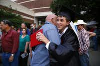 West High graduate Justin Klaus is congratulated by his grandfather Jimmy Walker after Friday night's graduation ceremony in Waco.