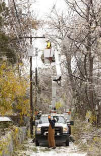 Oncor crews repaired a damaged pole in an alley along Poinsettia Drive in southwest Dallas on Dec. 7. The pole was damaged when an ice-laden limb fell on it.