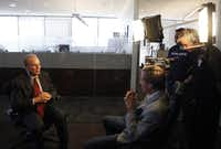 Roger Staubach films a video with Scott Murray at Jones Lang LaSalle in Dallas for a campaign marking the 40th anniversary of the NFL-United Way partnership.