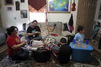 Maria Luisa Pedroza  (center) has her children (from left) Maria Jose Pedroza-Romo, 14, Gabriel Antonio Pedroza, 10, and Josue Pedroza, 7, involved in her art.Photos by Lara Solt  -  Staff Photographer