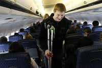 At DFW Intl. Airport, Connor Perry and other amputee patients from Texas Scottish Rite Hospital for Children board an American Airlines flight to Denver heading for the slopes of Winter Park, Colo., for the hospital's 33rd annual amputee ski trip.