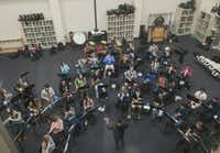 Reagan Brumley, director of instrumental music, leads a rehearsal for part of the high school band, which has grown from 45 members to 140 since 1998.