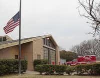 The flag flew at half-staff Tuesday outside Dallas Fire-Rescue Station 12 in honor of William Scott Tanksley, who died Monday while helping out at the scene of an accident.
