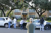 Media and bystanders look at the residence at 5700 block of  Marquita, where reportedly a person diagnosed with Ebola lived, photographed in Dallas on Sunday, October 12, 2014.  (Louis DeLuca/The Dallas Morning News)Louis DeLuca - Staff Photographer