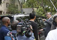 Dallas Mayor Mike Rawlings makes a brief appearance on Marquita, and is swarmed by media, as officials close off the residence at 5700 block of  Marquita, where reportedly a person diagnosed with Ebola lived, photographed in Dallas on Sunday, October 12, 2014.  (Louis DeLuca/The Dallas Morning News)Louis DeLuca - Staff Photographer