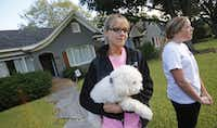 """Libby Franks (holding """"Lola"""") and Kara Lutley watch the action down the block on Marquita as officials congregate at the residence at 5700 block of  Marquita, where reportedly a person diagnosed with Ebola lived, photographed in Dallas on Sunday, October 12, 2014.  (Louis DeLuca/The Dallas Morning News)Louis DeLuca - Staff Photographer"""