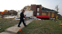 Randy McKeever looked over the damage to his tornado-damaged home in Forney on Friday, 10 days after the tornado.