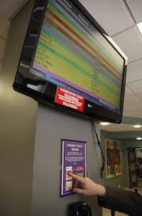 A waiting room monitor lets loved ones know the status of an emergency room patient with color-coded updates.