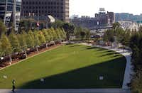It's quite a contrast: A green lawn and trees in the Klyde Warren Park sit above the bustle of traffic on the Woodall Rodgers Freeway.