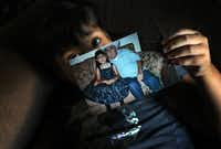 """Mariana Saldivar holds a picture of her father, who used to drive her to every medical appointment. """"She's blocked right now,"""" the girl's mother said. """"She doesn't want to know about the subject"""" of her father's death."""