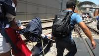 A video image shows a couple lifting a child's stroller as they exited the tunnel at Mockingbird Station on Thursday.