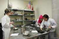 Caleb Helms, Sumaya Mohamud (center) and Yatziri Bravo work in the culinary arts classroom at Dubiski. Grand Prairie has seen passing rates rise and had 735 students transfer into the district from area schools this year.Mona Reeder  -  Staff Photographer