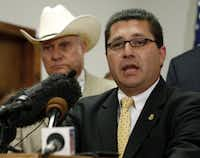 Diego Rodriguez (right), FBI agent in charge of the Dallas division, was joined by Kaufman Sheriff David Byrnes and others at the news conference on Thursday.