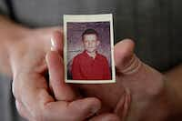 Gary Morrow holds a photograph of himself at 10 years old, a year younger than he was when President John F. Kennedy was killed.