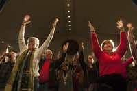 Winter solstice celebrants were led in standing yoga postures at the Cathedral of Hope on Friday.