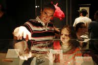 """Jorge Rodriguez-Larrain and his daughter, Daniela, look at a display during opening day of """"Animals inside out"""" at Perot Museum of Nature and Science in Dallas, Sunday, Sept. 22, 2013."""