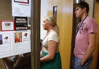Stephanie Schuljak, left, a Mansfield Legacy High student, has a rare hearing condition called superior canal dehiscence syndrome, or SCDS. She and one of her classmates Kyle Dragulski were asking to speak with the school principal about an upcoming community school project for the people in West, Texas.