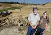 Wayne McEwen poses with granddaugther Halee Beasley, 13, at the site where he uncovered a well-preserved mammoth skeleton in his Ellis County gravel pit. He is donating the skeleton to the Perot Museum of Nature and Science in Dallas.Michael Ainsworth - Staff Photographer