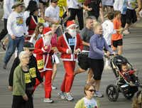 Many of the participants in the YMCA Turkey Trot wore costumes commemorating the season, such as this pair of Santas.