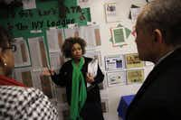 Dayanna Carson, principal at Lee A. McShan Jr. Elementary, explained the school's Ivy League program to Mike Miles and Nichole Brooks of Fellows Academy.