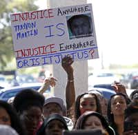 This sign's message became a rallying cry Friday for hundreds who gathered at Paul Quinn College to demand justice for Trayvon Martin, the Florida teen killed last month by a neighborhood watch leader.