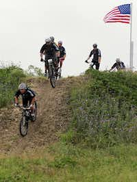 Former President George W. Bush led the pack down a hill during Friday's segment of his annual mountain bike ride for wounded vets.