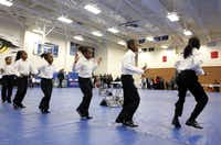 The Alpha Owls from Martin Weiss Elementary School performed during Chief on the Beat  on Saturday at Wilmer-Hutchins High School. Chief David Brown spoke to parents, teens and children.