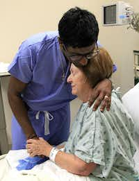 Dr. Rohan Jeyarajah hugged Mary Jane Moix, 69, of Conway, Ark., after they prayed with her family before her operation earlier this month at Methodist Dallas Medical Center. Dr. Rohan Jeyarajah wears a cross around his neck and addresses spirituality with his patients when he feels they are open to it.