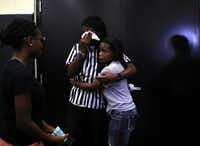 Jaztin Watkins (center), 18, hugged DaNesha Brown, 19, during Tuesday's memorial service for Polo Manukainiu, Gaius Vaenuku and Andrew Uhatafe. Monday evening's accident occurred about 85 miles north of Albuquerque, N.M.