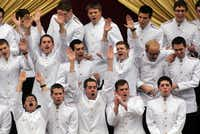 Texas A&M University Singing Cadets cheer during the inauguration ceremony.