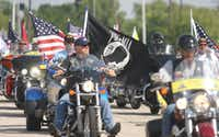 Members of the Patriot Guard Riders gather at Meacham International Airport for the arrival of the body of Army Spc. William R. Moody on Wednesday, July 3, 2013. They provided an escort for Moody, who was killed in an Afghanistan, to the funeral home.KELLEY CHINN - Special Contributor