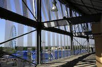 Jamie Carpenter's Light Veil offers an unusual photo framing opportunity when taking snapshots of Fair Park landmarks from Cotton Bowl concourses. Visible in this photo is the second set of mesh ribbons that are more obvious when seen from the interior.Nathan Hunsinger  -  Staff Photographer
