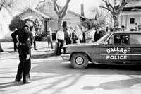A crowd gathered at the site in Oak Cliff where Officer J.D. Tippit was slain on Nov. 22, 1963.