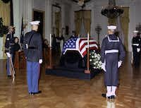 """November 23, 1963 - President Kennedy's body lies in state in the East Room of the White House. At front left, back to camera, is U.S. Marine's Lieutenant William F. Lee. In the days after the president's death, Lee found himself guarding JFK's casket - the """"Death Watch"""" - at the White House and the Capitol Rotunda."""