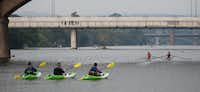 From left: Author Brad Tyer, Paul Hoffman and Ethan Wilensky-Lanford paddled on Lady Bird Lake at the annual Texas Book Festival on Saturday in downtown Austin.