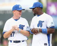 COWBOYS COACH  Jason Garrett (left) spoke to his star wide receiver, Dez Bryant, before the first pitch of Nowitzki's celebrity game.Andy Jacobsohn - Staff Photographer