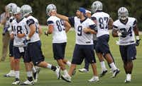 Dallas quarterback Tony Romo (9) directs teammates during the Dallas Cowboys first OTA practice at Valley Ranch in Irving on Tuesday, May 21, 2013.