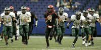 Cedar Hill quarterback William Coleturned in one of the most memorable performances in state championship history Saturday, rushing for 290 yards and three touchdowns in a 51-17 rout of Cypress Falls.ERICH SCHLEGEL - DMN Archives