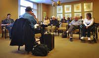Vincent Van Buren plays harmonica to a full room at The Legacy at Willow Bend in Plano for Howard Garson's 88th birthday celebration.  The birthday surprise was planned by Garson's daughter who had read the story about Van Buren in the paper in 2011.