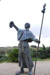 On the outskirts of Santiago de Compostela, sculptures of pilgrims at Monte do Gozo hail the cathedral in the distance.