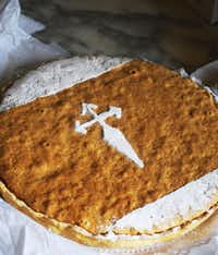 """The """"tarta de Santiago"""" topped with an image of the cross of St. James stenciled in powdered sugar is the city's signature sweet."""